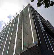 Grid cladding for EWIS facades